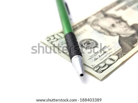 Twenty dollar and ballpoint pen - stock photo