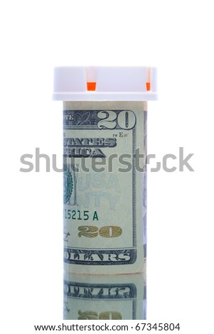 Twenty dollar bill wrapped around a prescription bottle, depicting the high cost of health care. Vertical format isolated over white with reflection. - stock photo