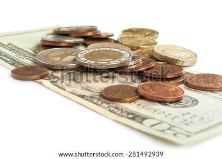 twenty dollars and coins on the white background - stock photo
