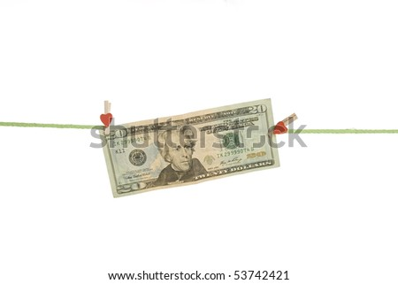 Twenty dollars hang on the rope with pegs. Isolated on white background - stock photo