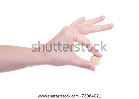 Twenty Euro cent coin in a hand isolated