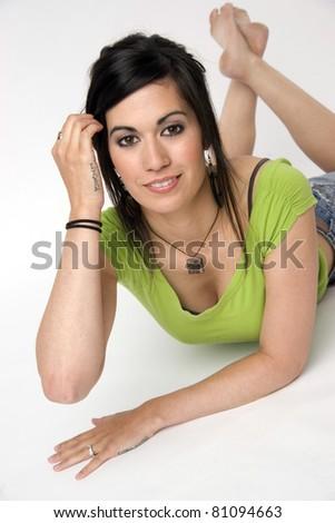 Twenty Something Attractive Woman Laying on White - stock photo