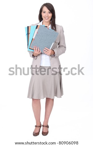Twenty something dressed for the office with various folders - stock photo