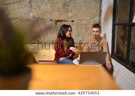 twenty something young couple working with his laptop