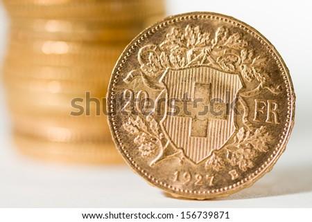 Twenty Swiss Francs gold coins - Selective focus - stock photo