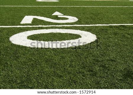 Twenty yard line of american football field - stock photo