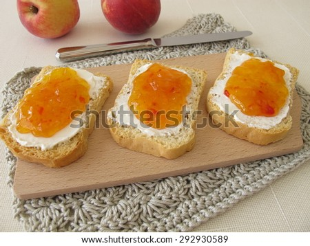 Twice-baked bread with with cream cheese and peach jam  - stock photo
