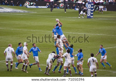 TWICKENHAM LONDON - FEB 12: Italian lineout catch at England vs Italy, England playing in white Win 59 -13, at RBS Six Nations Rugby Match on February 12, 2011 in Twickenham, England. - stock photo