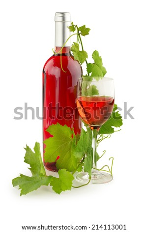 twig of grapevine twined on a rose wine bottle - stock photo