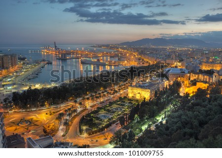 Twilight aerial view of Malaga city, the second most populous city of Andalusia and the sixth largest in Spain.