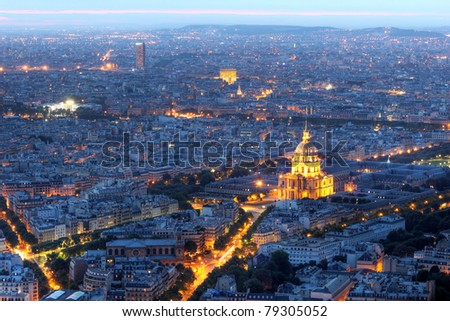 Twilight aerial view of Paris, France from Montparnasse Tower with Les Invalides - stock photo