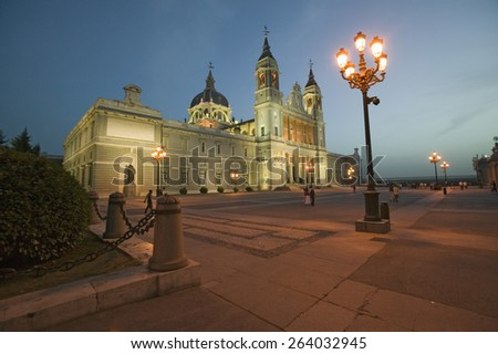 Twilight and lights coming on at Royal Palace in Madrid, Spain - stock photo