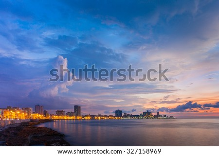 Twilight at Malecon, the famous Havana promenade, Havana, Cuba - stock photo