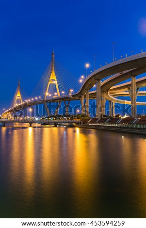 Twilight at Suspension bridge connect to highway waterfront, Bangkok Thailand - stock photo