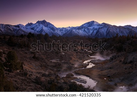 Twilight landscape above Hot Creek in the Eastern Sierra Mountains, California, USA. - stock photo