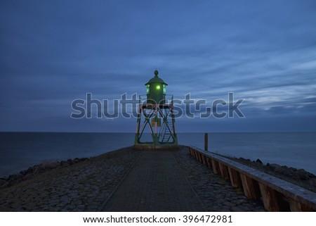Twilight lighthouse - stock photo