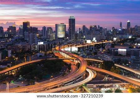 Twilight of Bangkok elevated road junction and interchange overpass - stock photo