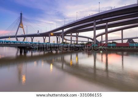 Twilight of Suspension bridge connect to Bangkok freeway overpass, Thailand - stock photo