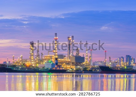 Twilight of the oil refinery plant.