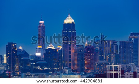 Twilight over city office building tower, cityscape background