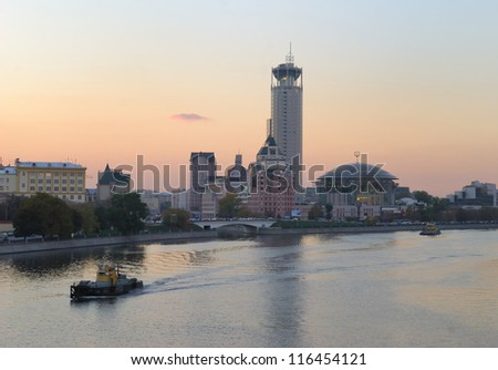 Twilight over Moscow. View on Kosmodamianskaya embankment and Moscow House of Music - stock photo