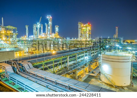 Twilight scene of chemical plant - stock photo