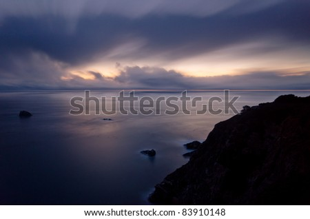 Twilight seascape at Big Sur, California with clouds and coastline - stock photo