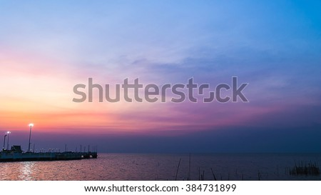 twilight sky with colorful sunset and clouds at beach - stock photo