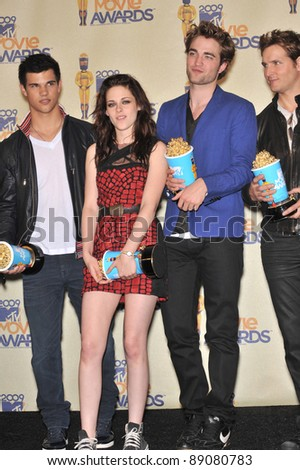Twilight stars Taylor Lautner (left), Kristen Stewart & Robert Pattinson at the 2009 MTV Movie Awards at Universal Studios Hollywood. May 31, 2009  Los Angeles, CA Picture: Paul Smith / Featureflash