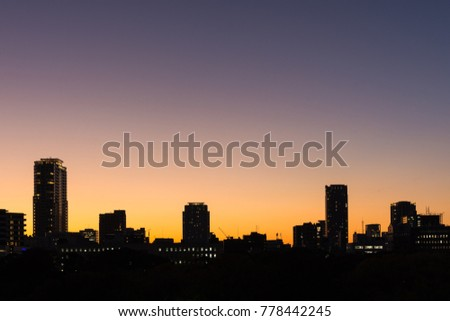 Twilight sunset with silhouette cityscape in Osaka Japan