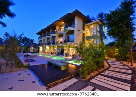 Twilight time of resort building colorful picture. - stock photo