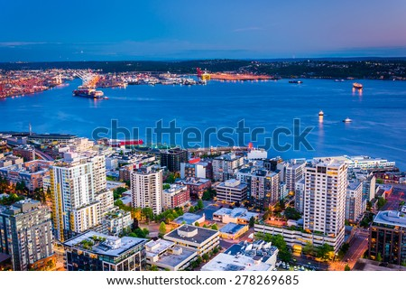 Twilight view of downtown Seattle and Elliott Bay, in Seattle, Washington. - stock photo