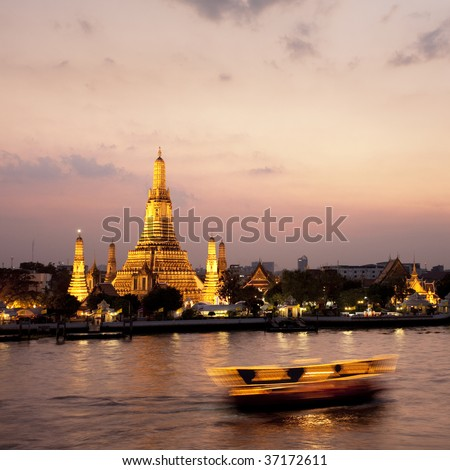 Twilight view of Wat Arun across Chao Phraya River during sunset in Bangkok, Thailand - stock photo