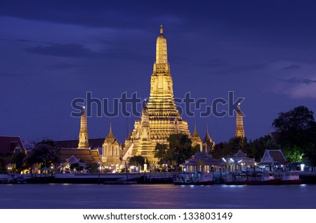 Twilight view Pra Prang of Wat Arun,  Famous Thai temple across Chao Phraya River during sunset,  Bangkok, Thailand - stock photo