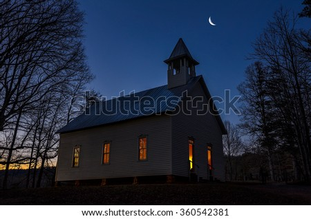 Twilight with crescent moon over primitive church in the Great Smoky Mountains National Park - stock photo