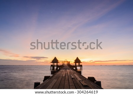 Twilight wood bridge at Djittabhawan Temple tourist attraction at Pattaya of Thailand