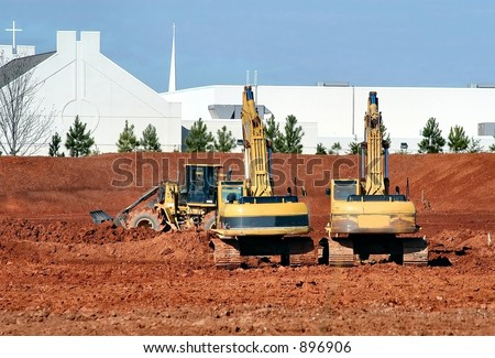 Twin Backhoes - stock photo