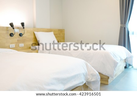 twin bed in loft style resort. - stock photo