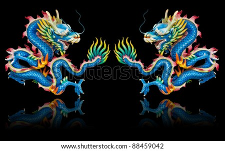 Twin blue dragon statues on black background with reflection