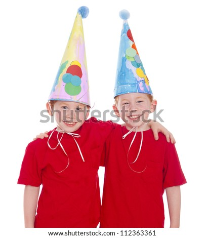 Twin boys wearing homemade party clown hats
