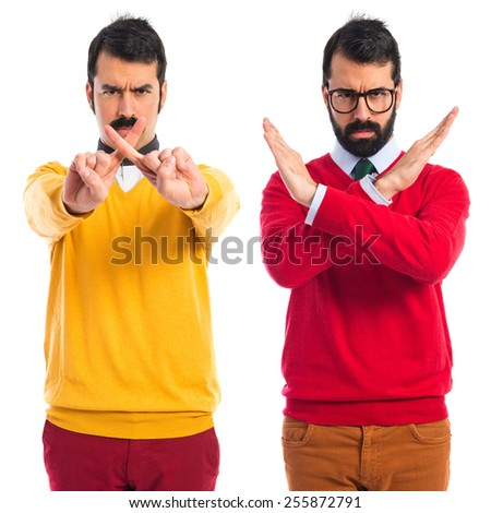 Twin brothers doing NO gesture  - stock photo