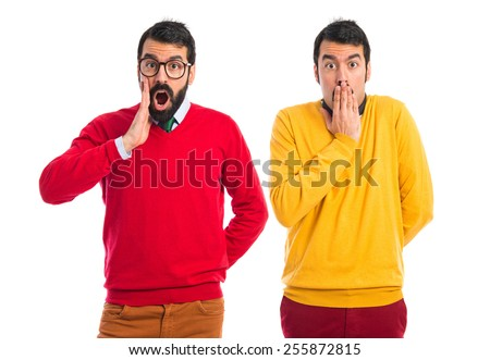 Twin brothers doing surprise gesture  - stock photo