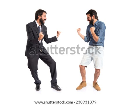 Twin brothers doing victory gesture over white background - stock photo
