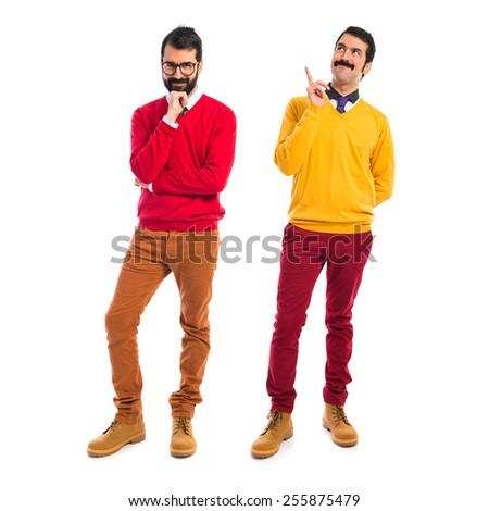 Twin brothers thinking over white background   - stock photo