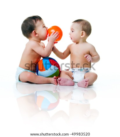 Twin brothers with balls isolated on a white background