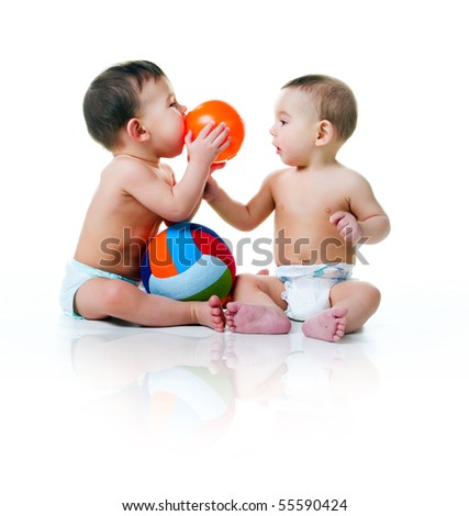 Twin brothers with balls isolated on a white background - stock photo