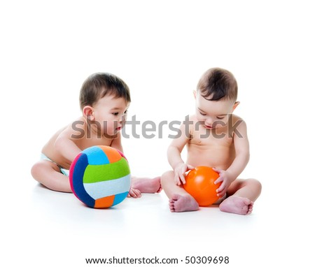 Twin brothers with bright balls isolated on a white background - stock photo