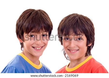 Twin brothers with casual clothes, smiling. Isolated over white background.