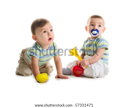 Twin brothers with shovel and rake isolated on a white background