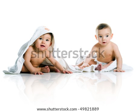 Twin brothers with towels isolated on a white background